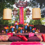 Indian Asian Moroccan Wedding Vintage Weston Gardens Fort Worth Nine Photography Gold Dust Vintage Rentals Sugar Bee Sweets We+You De Ma Fille Bridal lantern low table ribbon drum shade chandelier blue vases hot pink pillows pint tuck