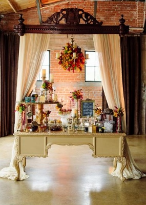 Brides-of-North-Texas-Gold-Dust-Vintage-Rentals-Jacqueline-Events-Celina-Gomez-Photography-gold-desk-buffet-sign-in-desert-bar-wood- hanging-head-board